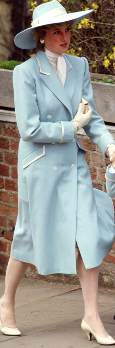 April 19, 1987: Princess Diana wearing a pastel blue Catherine Walker spring coat and a hat by Frederick Fox, walks with Prince William, who is holding hands with his first cousin Peter Phillips, to St. George's Chapel in Windsor Castle, Berkshire, to attend the royal family's Easter Service.