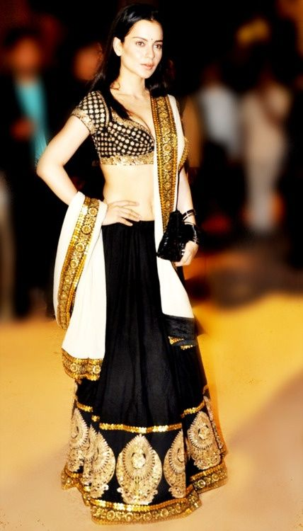 Kangana Ranaout in black and gold lehanga with white dupatta.