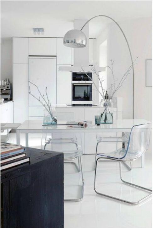 Modern white kitchen. Love the transparent seating