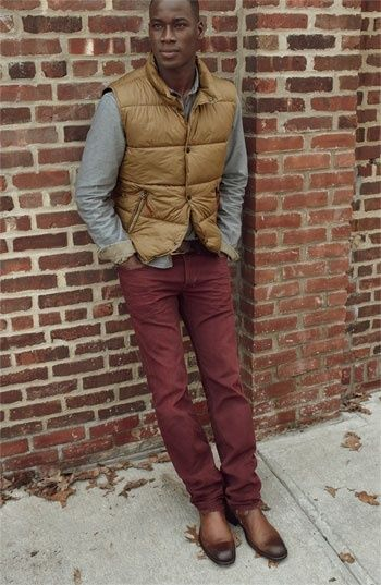 Try teaming a camel gilet with oxblood chinos for an easy to wear, everyday look. Grab a pair of brown leather monks for a more relaxed feel.   Shop this look on Lookastic: https://lookastic.com/men/looks/tan-gilet-grey-long-sleeve-shirt-burgundy-chinos/15865   — Grey Flannel Long Sleeve Shirt  — Tan Gilet  — Burgundy Chinos  — Brown Leather Monks