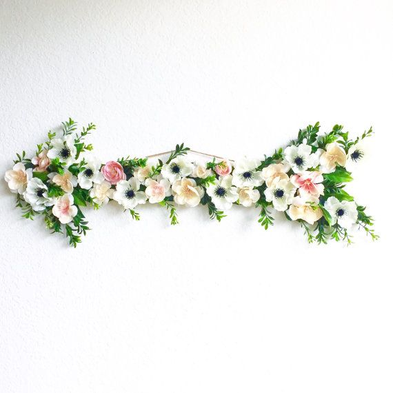 This listing is for the exact floral wooden arrow as shown in the photos above. It is a gorgeous boho chic floral arrow made with real wood and high quality pink and cream flowers and dainty greenery. Its the perfect whimsical touch for a childs room, a nursery, or as wedding decor! This arrow is about 29 inches long, from tip to tip including the flowers. Its 9 wide at its widest point. The depth from the wall is about 2 with the flowers on top of 1/3 wood. Its large size would make it the…