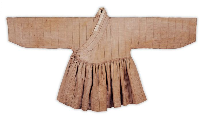 "Lined and quilted cheollik, found in  the grave of the wife of Chae Muyeok (1537-1594), identified as Kim. Important Folklore Materials 109-1. It is believed that Kim wore this coat as an everyday garment. ""The jacket-style upper part is rather short and under the armpits are attached a different kind of cloth called mu.  The garment also has quite wide hoejang (contrasting trim) and samsu (cuffs)....  As a garment from the early Joseon Dynasty, it has a right-angled collar."""