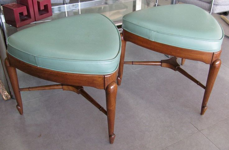 An extremely scarce pair of Mastercraft 3-legged ottomans, c.1960's/70's. I got these about 9 years ago. To this day, I've only ever seen a Mastercraft table and dining chairs listed on 1stdibs at BG Galleries with this leg. Most MasterCraft furniture I see is chinoiserie is style, and is either all brass or ebonized lacquered wood with brass details.