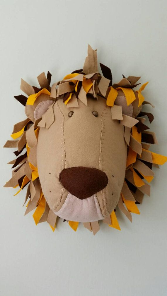 LEOPOLD LION Approximate dimensions - 12 high x 11 wide x 11 deep Colour - Brown, Beige, Yellow, Tan THE PERFECT ALTERNATIVE TO HAVING TO GO OUT AND SHOOT YOUR OWN ANIMAL TO HANG ON A WALL!!! WONDERFULLY WACKY HANDMADE FABRIC CREATIONS! All my Wall Mounted Animal Heads are handmade by