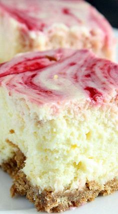 Lemon Raspberry Cheesecake Squares ~ A smooth and creamy lemon cheesecake with a raspberry swirl topped on a homemade graham cracker crust.