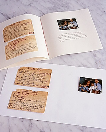 Make a recipe book using copies of original recipe cards and family photos for a personal gift.
