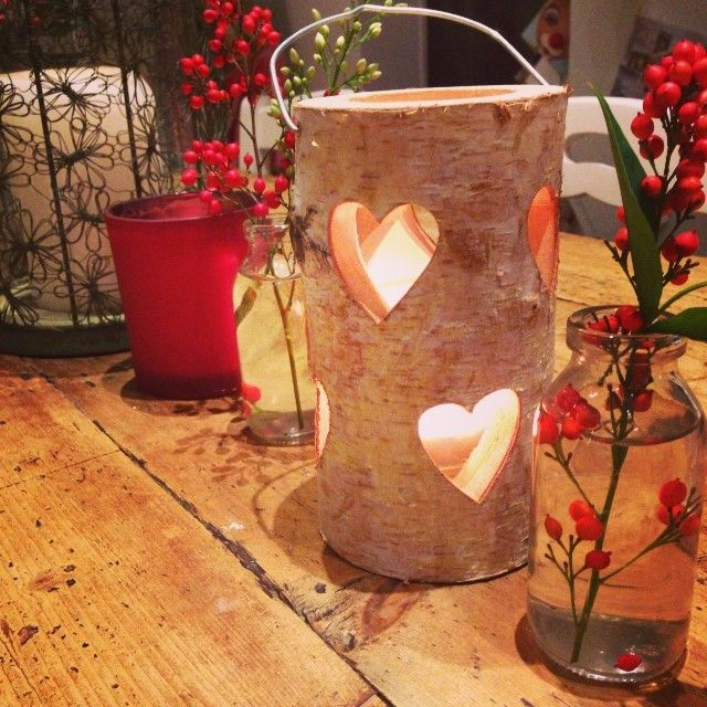 For a festive table i use old milk bottles with berries from the garden and little cut out lanterns for a cosy feel