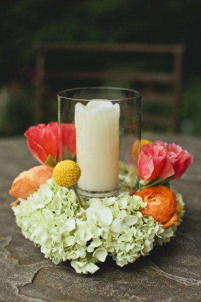 White Pillar Candle Surrounded By Flowers
