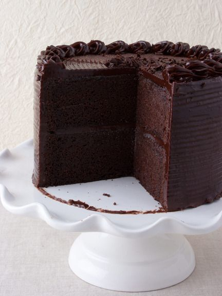 Jack Daniels Cake, It's made with bourbon-infused chocolate sponge cake and slathered in creamy, chocolate ganache. With a scoop of vanilla ice cream, a slice of this boozy cake can't be beat.