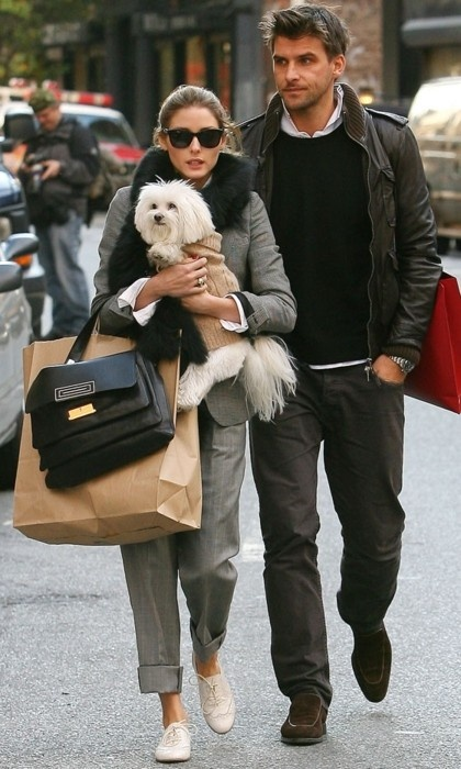 What a fancy doggy. Haha but that guy seriously needs  to help the girl carry some things!! .a.s.