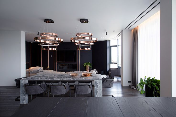 In one of Kiev's Luxury Apartments complex PecherSKY, the architectural and interior design studio YoDezeen masterfully employ a tasteful palette, design furniture and stunning copper surfaces to compose a bespoke high-end design