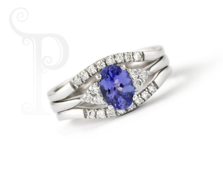 Handmade 18ct White Gold Tri Band Ring Set With an Oval Cut Tanzanite and Round Brilliant Cut Diamonds