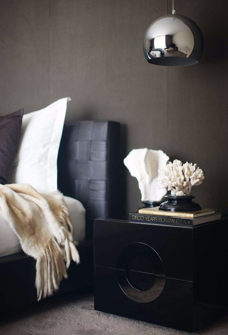 Black modern nightstand design on a dark, sleek master bedroom.