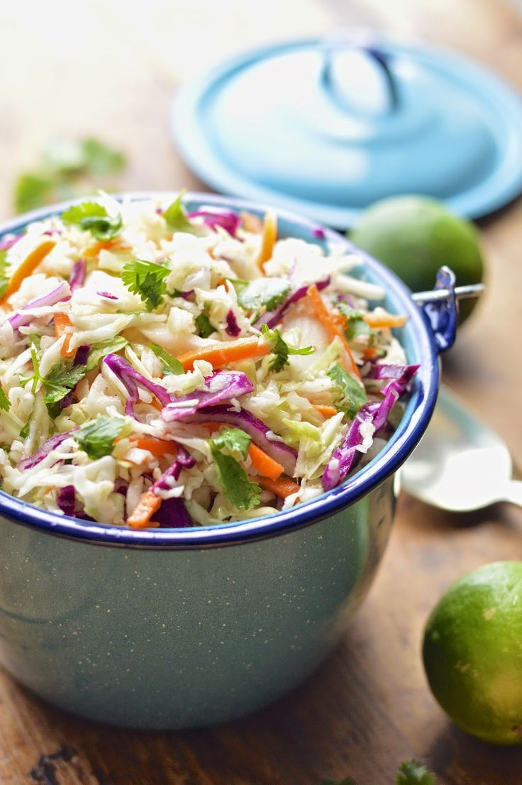 This Mexican cole slaw is lightened up with fresh lime juice and cilantro and takes about 5 minutes to make.