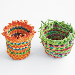 Baskets made from old T-shirts! I'm thinking... maybe some mod podge on the outside to make it more structural and sturdy??
