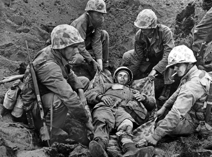 Striking images from the battle of Iwo Jima: A soldier of the American marine infantry wounded while landing on the island of Iwo Jima in Japan is transported to an armored vehicle on March 3, 1945.