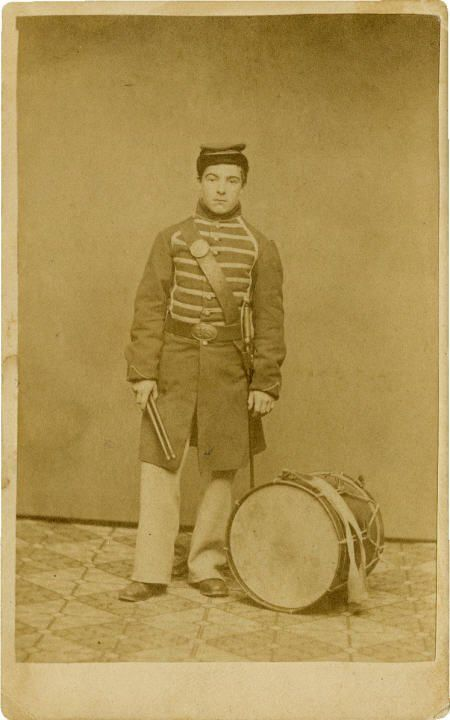 CDV Portrait of Drummer Edwin Burr 10th and 11th Rhode Island Inf. The soldier in this carte de visite wears regulation musician's frock coat, bummer's cap, over the shoulder sling with M1840...