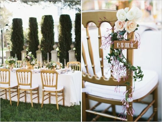 gold and white reception seating with floral bride seat sign