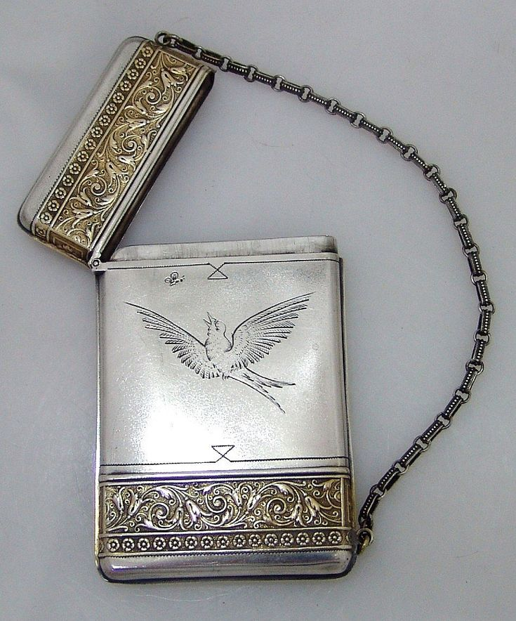 American Sterling Silver Aesthetic Calling Card Case with die-rolled gilt floral and scroll bands on the top and the bottom of the case made by Wood & Hughes., c.1882