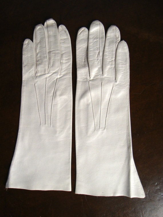 Gorgeous Vintage 1950s Wedding Caresskin Cream Gloves by Superb Glove Co.,  Size 6, $24.50. But is it a bad idea to get her almost-white gloves? Will they end up ruined and dirty?