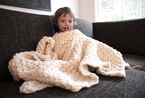 """I love giant knitted blankets--even better that this yarn is called """"Fat & Happy."""" Cute!"""