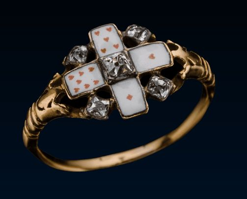 Card Game Ring | The enamel has four playing cards. A diamond is set between each card, and there is a bezel-cut diamond in the center. This ring is reminiscent of the time and money 18th century men and women spent gambling on card games.