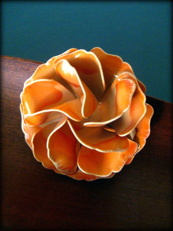 An orange blossom pin adds whimsy to any outfit