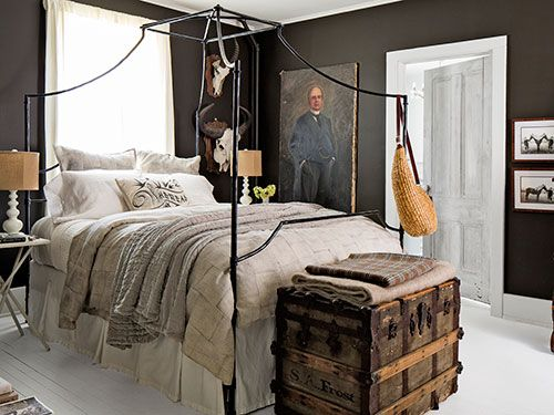 This bedroom boasts white floors, dark chocolate walls, and amazing collections. The bed? From PB Teen!