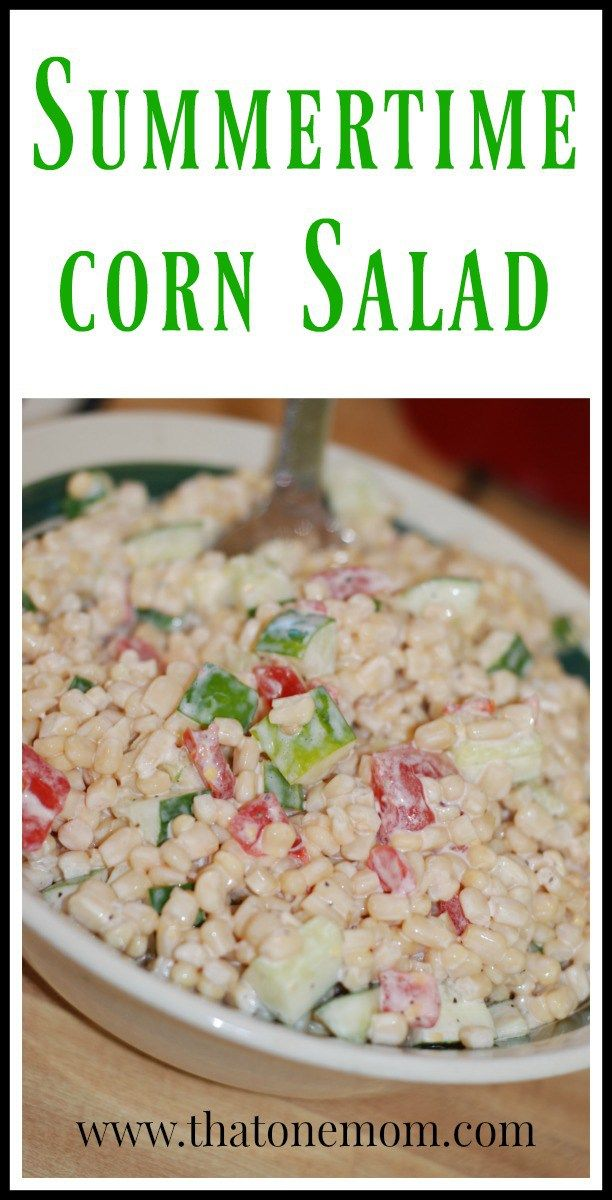 Summertime Corn Salad can be prepared any time of the year, but it tastes so much better with that garden-fresh produce!  www.thatonemom.com #corn #tomatoes #cucumber #sidedish #picnic
