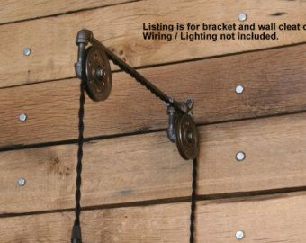 Hand Crafted in the USA by D.G. Bowden   Industrial Hanging Pendant Light Wall Sconce on a Steel Pipe and 2 Pulleys.  Options: Cord Colors - Black, Brown, Sand and Red Bracket Length - This is the length that your bracket will come out from the wall. The distance from the wall that your socket will hang. **THIS LIGHT HAS NO on/off switch with the porcelain socket pictured. If you need a switch, please add one of these to your order…