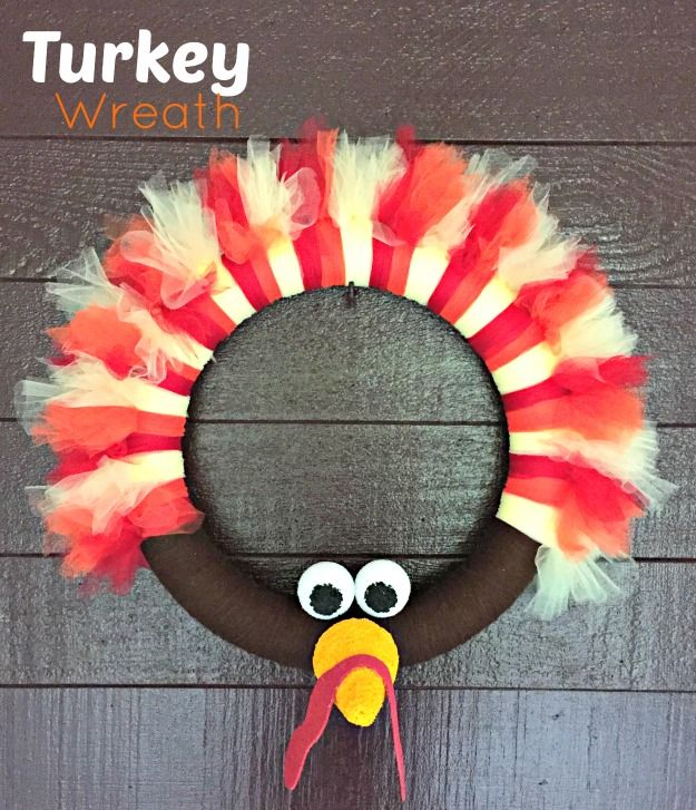 Turkey Wreath Thanksgiving Craft - use a pool noodle as the wreath form and secure the ends with duck tape!