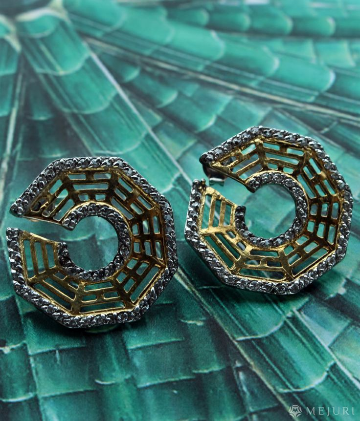 These gold and silver earrings are inspired by the art of feng shui.