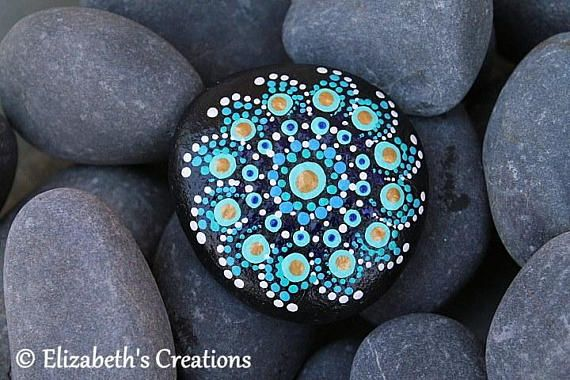 Beautiful hand painted Mandala Stone . This stone measures approximately 2.5 x 2.5. The colors are very rich and vibrant as you can see and this design is made entirely from hand painted dots.... dot by dot! Shipping is done thru USPS. I ship priority so it is a fixed cost. The Rocks