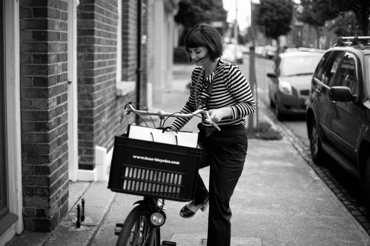 Dutch bicycles and fashion at Dolls Dublin - Petria parking her Dutch bike