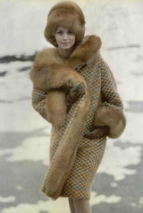 .Beautiful vintage photo. The red fox fur on the collar and cuffs makes you want to get wrapped in the coat.
