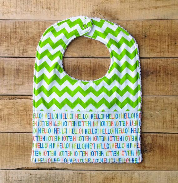 Fashionable and practical! This is a fun accessory while keeping your babys outfit drool, food and spit up free. This food bib makes a unique and cherished shower gift that would be well used and very handy for any new mom. It is a dual fabric bib with both chevron and fun hello print! I was recently inspired by my own children's need for a good quality bib that had a good amount of coverage. This stylish bib is great for the messy blessings The bib is topped with 100% Cotton, backed with…