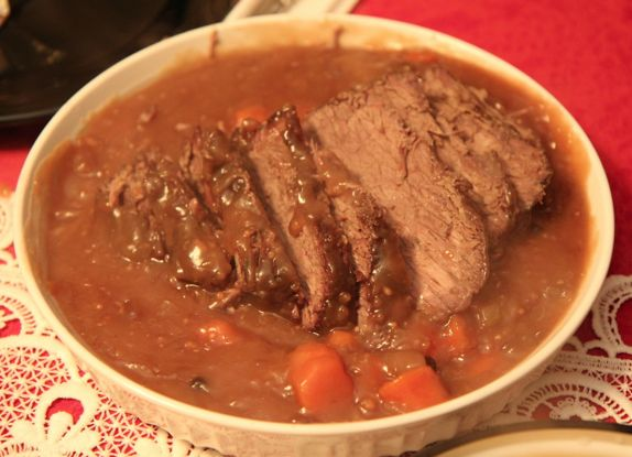 If you've never had authentic German sauerbraten, you're missing out. It's a German pot roast that is marinated for several days in a mixture of vinegar or wine, water, herbs, spices and seasonings... Oktoberfest!