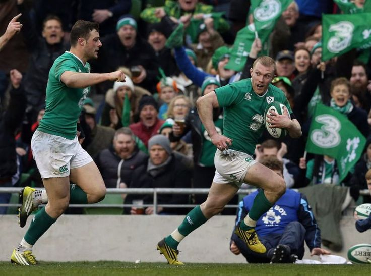 Ireland's Keith Earls, right, runs,  on his way to scoring his side's second try, during the Six Nations rugby union international match between Ireland and Scotland, in Dublin, Ireland,  Saturday March 19, 2016. (Brian Lawless/PA via AP) UNITED KINGDOM OUT