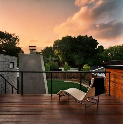 I like the idea of a brown/natural wood look for deck with contrasting rail  contemporary patio by MAC Architecture Construction