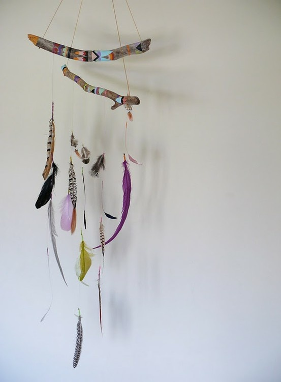 american indian style mobile of painted twigs and feathers