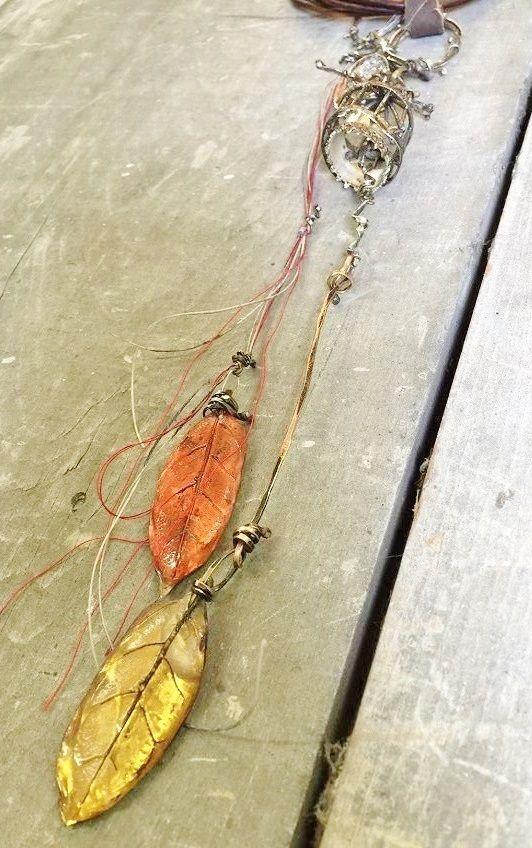 cast and carved leaf pendants in resin by Susan Lenart Kazmer