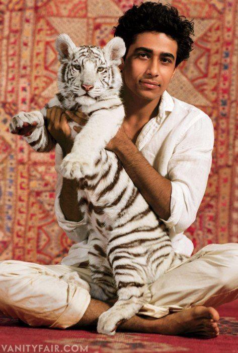 Suraj Sharma and a mini Richard Parker  Photos: The 2013 Hollywood Portfolio | Vanity Fair