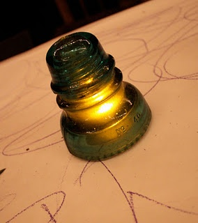 flameless candle under an insulator...decorated mine with primitive ribbon and jingle bells for Christmas.