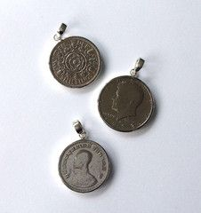 New Pendants, handcrafted vintage coins form around the world 925 Silver.