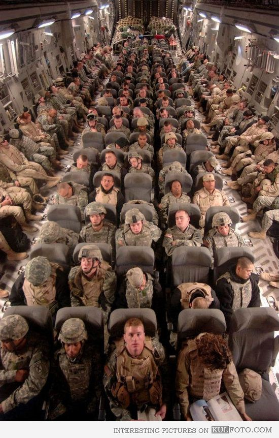 Soldiers returning home - Military plane full of tired soldiers returning home from Afghanistan.
