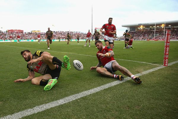 Josh Mansour Photos Photos - Josh Mansour of the Panthers scores a try during the round four NRL match between the St George Illawarra Dragons and the Penrith Panthers at WIN Stadium on March 27, 2016 in Sydney, Australia. - NRL Rd 4 - Dragons v Panthers