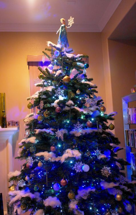"""Disney's Frozen inspired Christmas tree with Elsa tree topper. The best I have seen so far! """"Let it go!"""""""