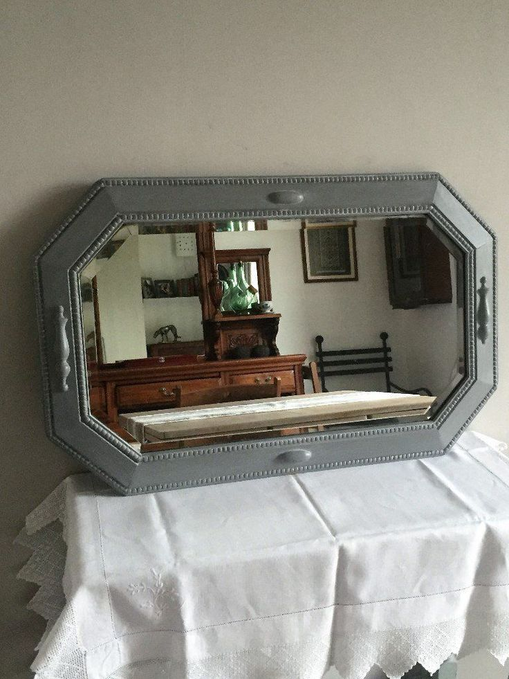 Bevelled mirror with beading.