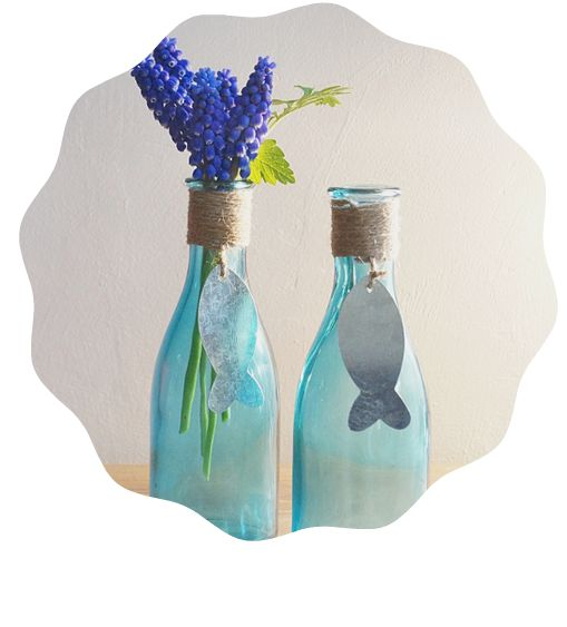 Perfect bathroom ornament These pretty blue tinted glass bottles make the perfect bathroom ornament, or brighten up a spare bedroom dresser.  I can see these filled with freshly cut lavender!  Finished with silver coloured fish decorations.  185mm tall. Get them from pinkyred.co.uk