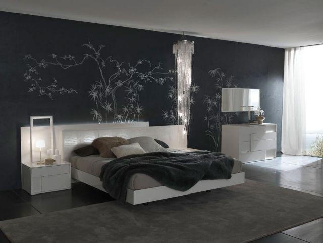 papier peint chambre adulte sur un fond noire grand lit et coussins
